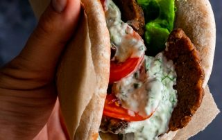 vegan seitan gyros served in a pita with Tzatziki