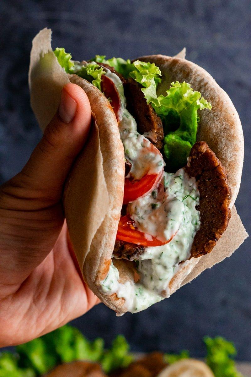vegan seitan gyros served in a pita with Tzatziki